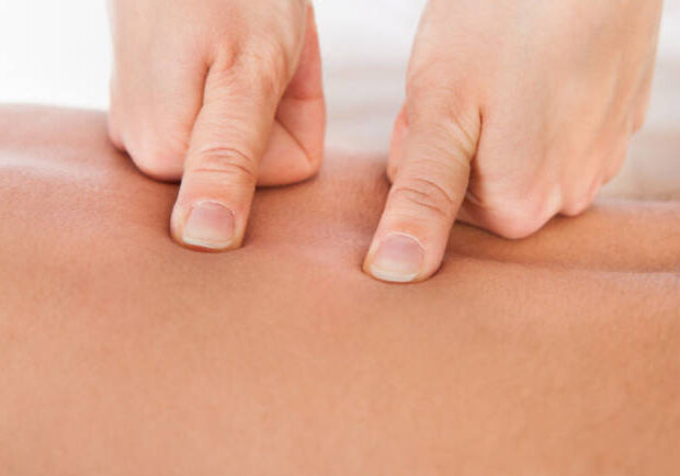 25156371 - close-up of person receiving shiatsu treatment from massager